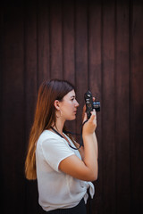 Young girl posing with a vintage camera