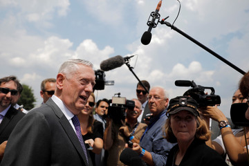 U.S. Defense Secretary James Mattis talks with journalist as he wait for the arrival of British Defense Secretary Gavin Williamson at the Pentagon, in Washington, D.C.