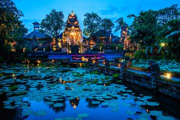 Evening atmosfere iof the Pura Saraswati Temple with beatiful lotus pond, Ubud, Bali in Indonesia Wall mural