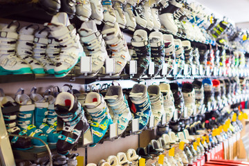Image of colorful ski boots on showcase