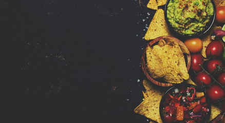 Mexican Food Concept, Nachos, Guacamole, Salsa Sauce, Black Background, Top View and toned image