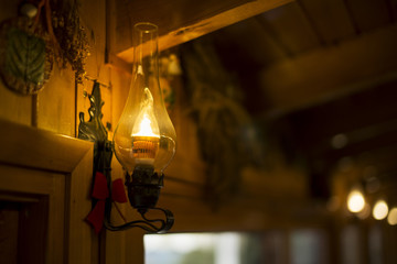 Retro lamp in a wooden place.