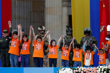"""Children wearing t-shirts that read """"The future belongs to all of us"""" participate in the swearing-in ceremony of Colombia's new President Ivan Duque at the Bolivar Square in Bogota"""
