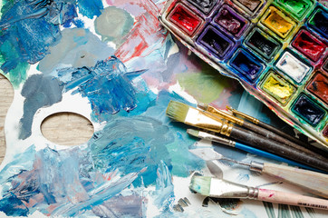 Artist paint brushes and watercolor paintbox