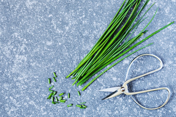Bunch of chives on stone background,
