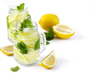 Mason jar glass of lemonade with mint on white background