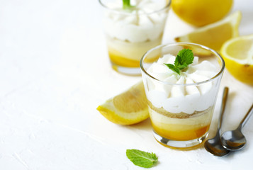 Limoncello - italian Dessert.  Lemon Cheesecake Mousse with Whipped Cream in cups. Summer dessert.