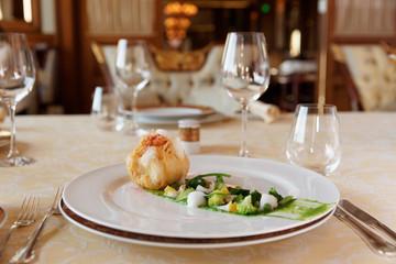 Creative fish dish in classic restaurant