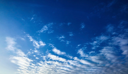 The blue sky with clouds, vivid background
