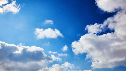 The blue sky with clouds. Spring, winter or summer heaven. Vivid background