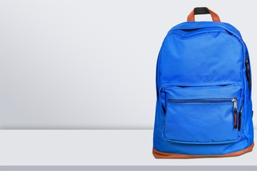 Blue school backpack on table
