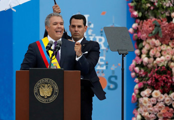 Colombia's new President Ivan Duque gives his speech after being sworn in during his inauguration ceremony at the Bolivar Square