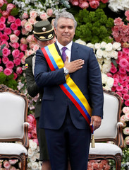 Colombia's new President Ivan Duque gestures during his swear-in ceremony at the Bolivar Square, in Bogota