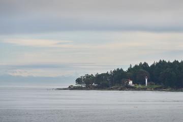Georgina Point Lighthouse, Mayne Island, BC. Georgina Point Lighthouse on the shore of Mayne Island, BC, Canada.