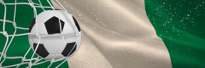Composite image of soccer ball in goal net