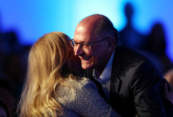 Alckmin of the Brazilian Social Democracy Party (PSDB), candidate for Brazil's presidential election, embraces TV presenter Angelica Huck during the GovTech seminar in Sao Paulo