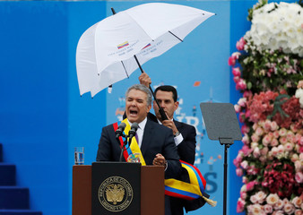 Colombia's new President Ivan Duque addresses the audience during his swearing-in ceremony at Bolivar Square in Bogota