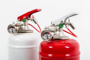Top detail of Chemical fire extinguisher isolated on white background
