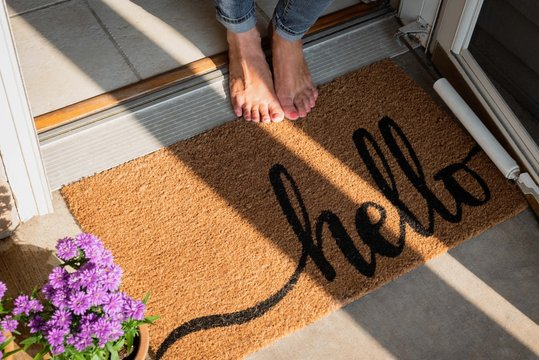 welcome mat in front of new home