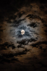 Moon Peering Through The Clouds