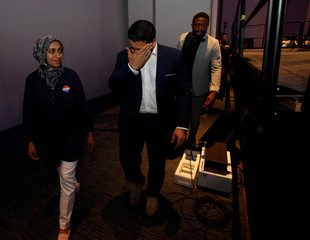 Democratic candidate for Governor Abdul El-Sayed (R) walks off stage with his wife Sarah Jukaku after conceding defeat in Detroit