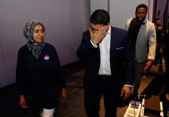 Democratic candidate for Governor Abdul El-Sayed walks off stage with his wife Sarah Jukaku after conceding defeat in Detroit