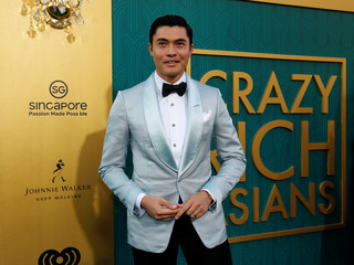 "Cast member Golding poses at the premiere for ""Crazy Rich Asians"" in Los Angeles"