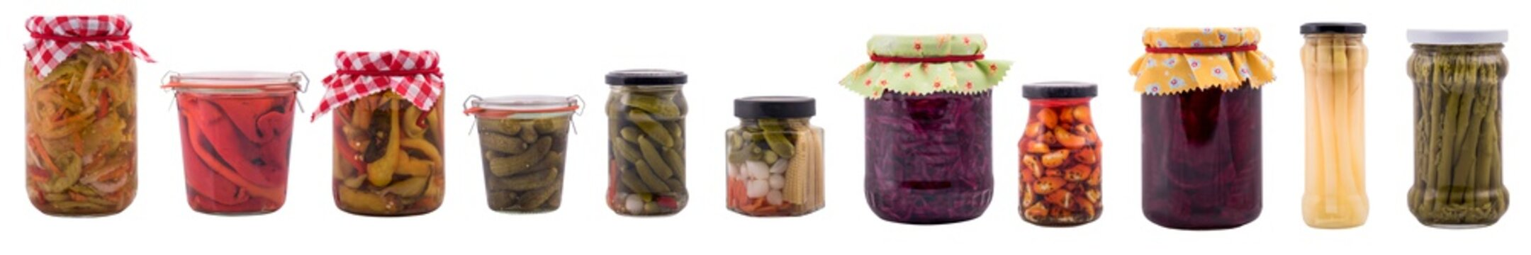 Wide banner with preserved food in jars, isolated on white