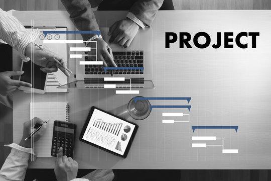 Business People Analyzing  PROJECT MANAGEMENT updating Gantt chart
