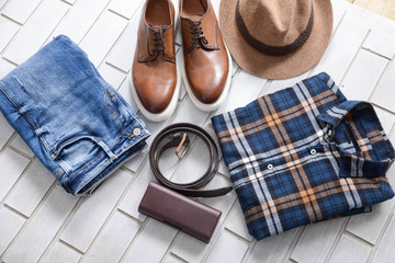 Set of mans fashion and accessories on brick wall background