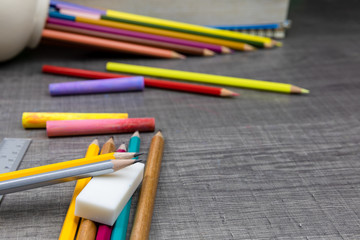 Pencils, notebooks, erasers, rulers, books on the table the concept back to school.