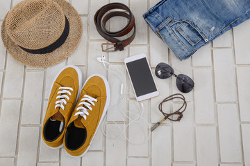 Set of mans fashion and accessories on white brick wall