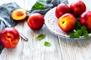 Plate with fresh nectarines