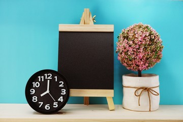 space copy background with alarm clock and artificial plant