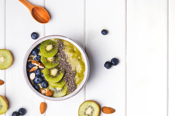 Green smoothie bowl with kiwi, blueberry and chia seeds Wall mural