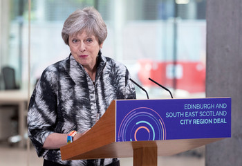 Britain's Prime Minister Theresa May speaks at the University of Edinburgh before signing the Edinburgh and South East Scotland City Region Deal in Edinburgh, Scotland