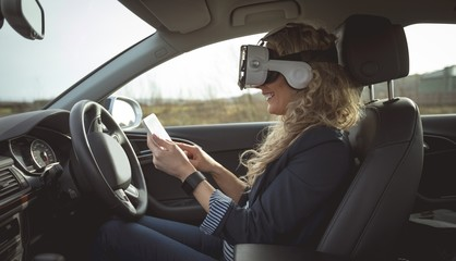 Female executive using digital tablet and virtual reality