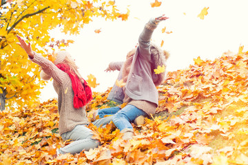 laughing playing kids in autumn