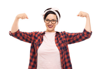 Pretty pin-up girl wearing glasses showing both her biceps.