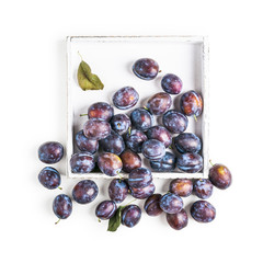 Plums on tray