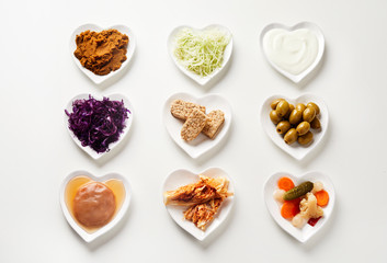 Variety of fermented foods in heart-shaped dishes