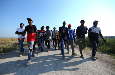African migrant laborers stage a march to protest against their work conditions in Italy, following the death of 16 of their colleagues in two separate road accidents, near Foggia