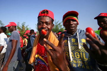 African migrant laborers gesture during a march to protest against their work conditions in Italy, following the death of 16 of their colleagues in two separate road accidents, near Foggia