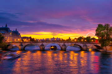 Sunset view of Seine river, Pont Royal and Orsay Museum (Musee d'Orsay) in Paris, France