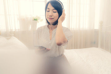 the 20s girl wake up and listen music in morning