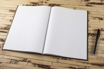 Top view notebook on wooden texture