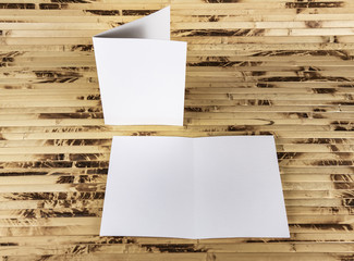 Mockup of white booklet on bamboo background.