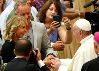 Singer Sting and his wife Trudie Styler greet Pope Francis during the general audience at the Paul VI Hall in Vatican