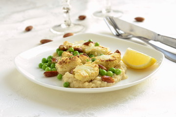 Salad with roasted cauliflower and green peas, almonds served on vegetable puree