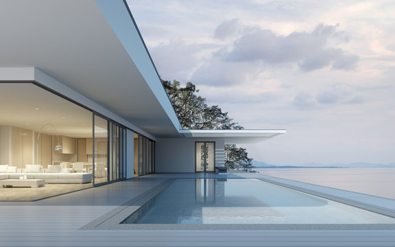 Perspective of modern building with terrace and swimming pool on sea view background,Idea of family vacation. 3D rendering.